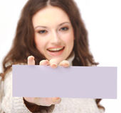 Young woman holding an empty billboard — Stock Photo