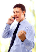 Young businessman using mobile phone — Stock Photo