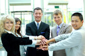 Handshake and teamwork — Stock Photo