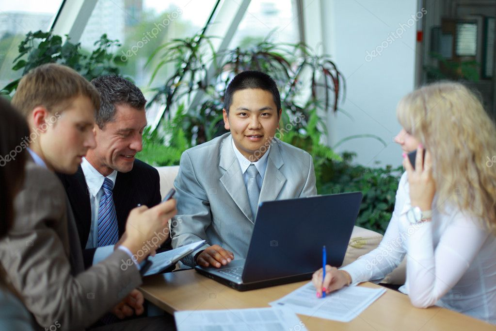 Team of multi ethnic business discussing work — Foto Stock #3231396