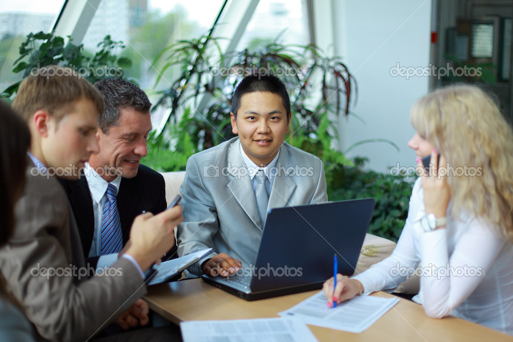 Team of multi ethnic business discussing work  Photo #3231396