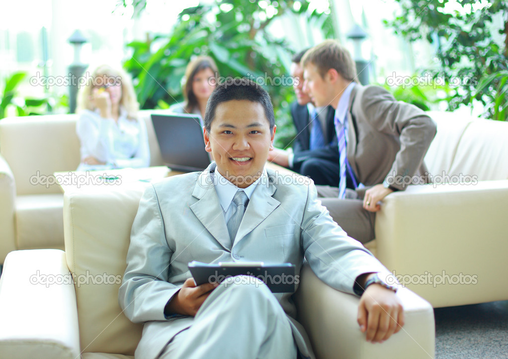 Asian business man with colleagues at a conference in the background  — Stock Photo #3233471