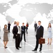 Businessmen standing in front of earth map — Stock Photo #4174431