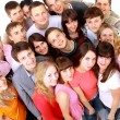 Top view portrait of happy men and women standing together and smiling — Stock Photo