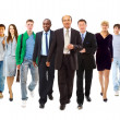 Happy young businessman standing in front of her team — Stock Photo