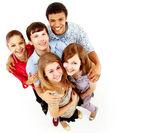 Casual grupp lycklig isolerade över vita — Stockfoto