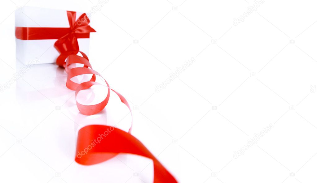 gift wrapped with a red ribbon on a white background — Stock Photo #4176462