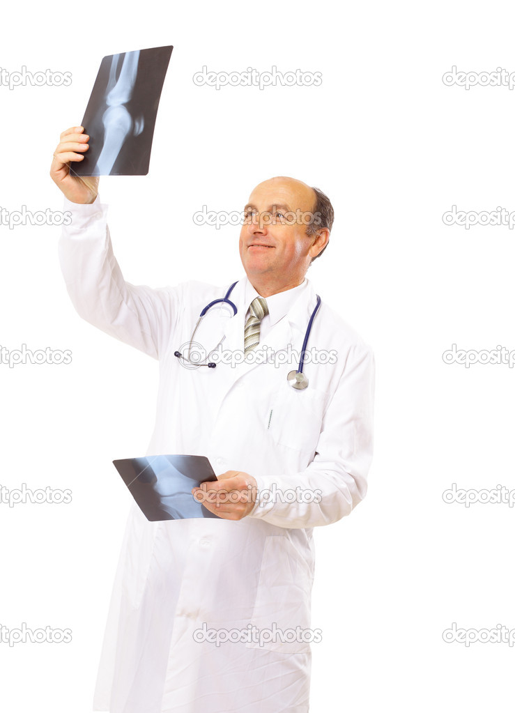 Young Doctor looking at an x-ray   Stock Photo #4176820