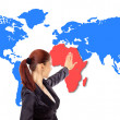 Happy young woman pointing on map — Stock Photo