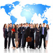 Businessmen standing in front of an earth map — Stock Photo #4221541