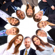 Group of business standing in huddle, smiling, low angle view — Stock Photo #4221752