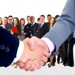 Photo: Handshake isolated on business background