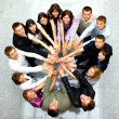 Top view of business with their hands together in a circle - Stock Photo