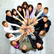 Top view of business with their hands together in a circle - Stok fotoraf