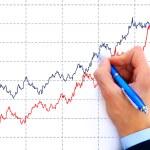 Businessman drawing an organization chart on a white board — Stock Photo