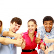 Happy guys and girls expressing happiness by showing thumbs while smiling - Stock Photo