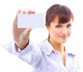 Portrait of a beautiful businesswoman holding a white card — Stock Photo