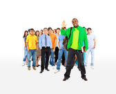 Group of the young smiling students. Over white background — Stock Photo