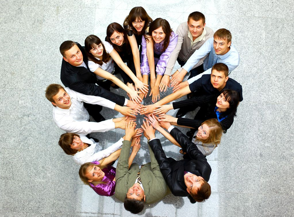 Top view of business with their hands together in a circle — Stock Photo #4222129