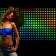 Beautiful young woman dancing in the nightclub — Stock Photo #4233404