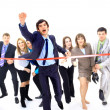 Businesspeople crossing the finish line — Stock Photo #4233714