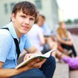 Young man read book — Foto Stock