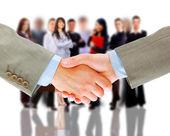 Handshake and business team — Stock Photo