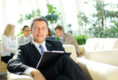 Portrait of a ambitious business man in an office environment — Stock Photo