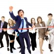 Businesspeople crossing the finish line — Stock Photo #4248620