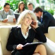 Stock Photo: Happy young business woman talking on cellphone