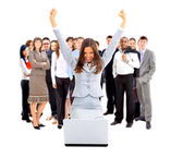 Business woman with her hands raised while working on laptop — Stock Photo