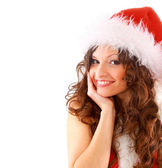 Happy girl dressed as Santa with Christmas presents — Stock Photo