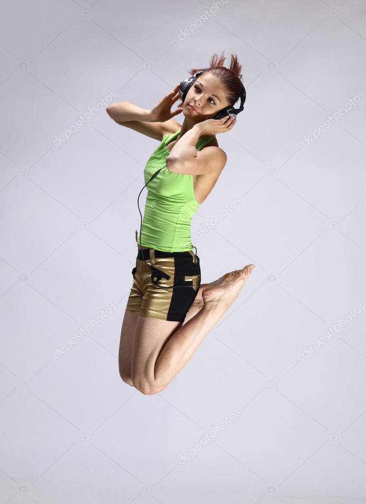 Beutiful young girl dancing and listen music  Stock Photo #4248583