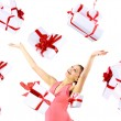 Excited attractive woman with many gift boxes and bags — Stock Photo