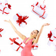 Excited attractive woman with many gift boxes and bags - Stock Photo