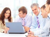 Group of happy business in a meeting at office — Stock Photo
