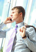 Young happy businessman calling on mobile phone, outdoor, smiling — Stock Photo