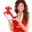 Young woman with gifts. Shot in studio. — Stock Photo #4277645