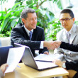Business shaking hands, finishing up a meeting — Stockfoto #4277695