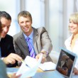 Business meeting - manager discussing work with his colleagues — Stock Photo