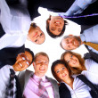 Group of business standing in huddle, smiling, low angle view — Stock Photo #4279712