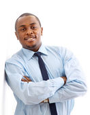 Portrait of a happy young African American business man with hands folded o — Stock Photo