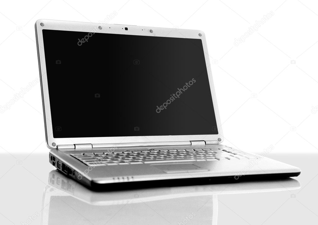 Modern laptop isolated on white with reflections on glass table. — Stock Photo #4277932