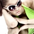 Stock Photo: Womin sun glasses. Fashion portrait
