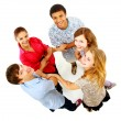 Stock Photo: Top view of group of friends standing together isolated on white floor