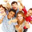 Group of happy joyful friends standing with hands up isolated on white back - Стоковая фотография