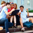 Students sitting together at school — Stock Photo #4295907