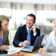 Business man speaking on the phone while in a meeting — ストック写真 #4296428