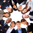 Group of business standing in huddle, smiling, low angle view — Stock Photo #4296571