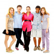 Happy teen young boys and girls standing together against white background — Stock Photo #4297558
